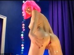 merry pie fucks her pussy with a dildo with a plug in her ass.