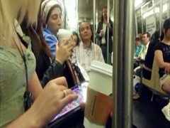 Blonde downblouse cleavage on subway train