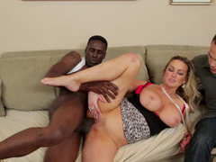 A blonde that loves cock is fucked next to her cuckold husband