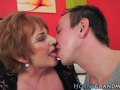 Horny granny is tempted to try a young huge dong to ride on