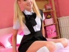 Blonde with pigtails pose for a cam