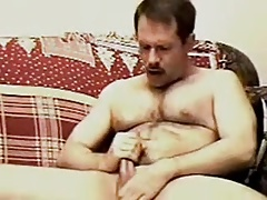 Mustached daddy blows a load in his own mouth