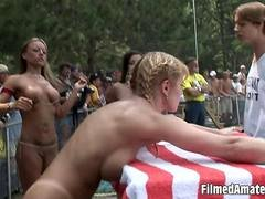 Slim stunning amateur babe shows off her body at nudist party