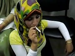 hot arab hijab girl smoke a cigarette for the first time
