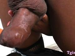 Thai ladyboy boning her ass with a dildo while jerking