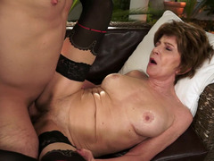 A redhead granny is getting a dildo and a cock in her wet cunt