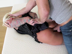 A blonde is getting fucked in her black leather corset today