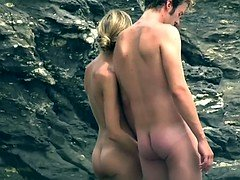 Public voyeur video is showing a hot chick lying on nudist beach
