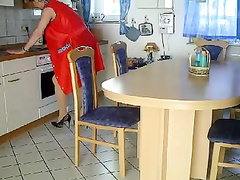 German mature fisted on the table