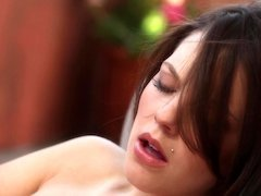A brunette with natural tits is teasing her cunt lips close up