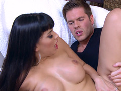 A milf that has big fake tits is getting pounded really hard
