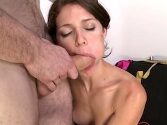 Petite thing with large puffy nipples is getting a cock in her mouth