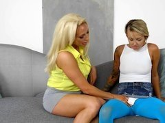 A blonde with a pretty face is with her friend, fucking her