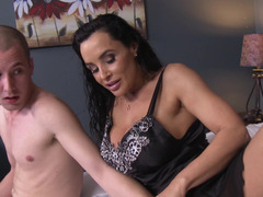 A raven haired milf with a hairy pussy is getting rammed on the bed