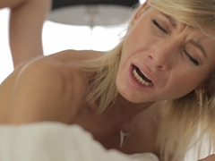 A blonde with form boobs is getting her tight cunt pounded hard