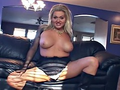 Mandy plays with her busty transvestite
