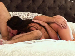 A big ass babe with large tits is fucked sideways on the bed