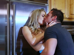 A girl that loves getting fucked is doing just that in the kitchen