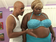 A black woman that has a fat body is sucking a big meaty pecker