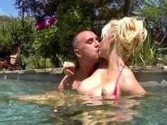 A blonde dips in the pool and then she gets fucked in the living room