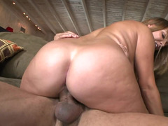 Blonde with a big ass and some large natural tits is sucking a dick