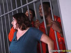 A redhead slut gets involved into threesome with prisoners