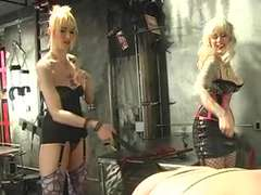 two scorching tatted mistresses torture their sub