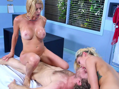 Two chicks tease and stimulate one another in a threesome