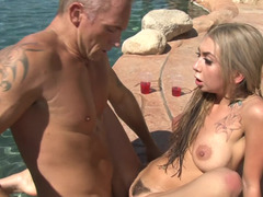 Several women are getting fucked in a hot orgy by the pool