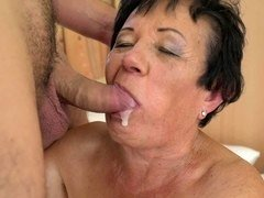 A granny that likes young men is getting undressed by a dude