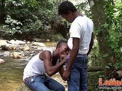 Latinos in jeans and T-shirts have oral outdoors