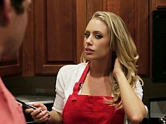 Blonde housewife in the kitchen