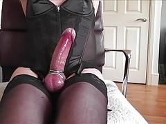 Black Corset, Stockings, Steel Rings and Cum