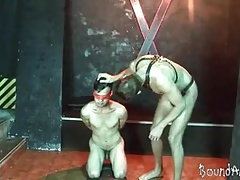 Nude young slave gets blindfolded at the dungeon