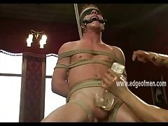 Tattooed hunk is tied up and gagged