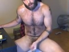 Hairy bearded beast fucks his hole with a toy