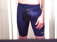 Bulging and pissing my blue lycra spandex running shorts