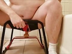 Riding on sex stool.
