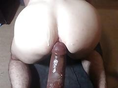 pushing big black dildo
