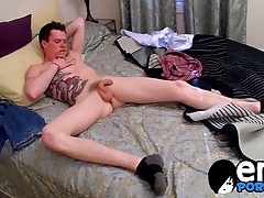 Cute gay dude wanks his hairy cock until he unloads his jizz