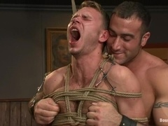 Spencer Reed and Zach Alexander play gay BDSM games in a bar