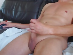 Wanking shaved cock