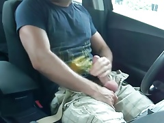 Hunk jerks off in his car in public