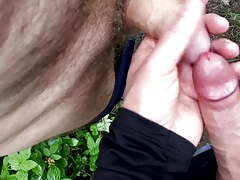 2 guys wanking down the woods