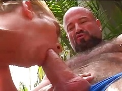 Daddy shows his boy what to do