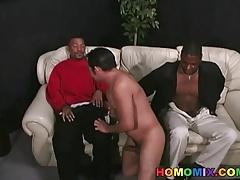 Black men sharing a cheerful latino dude