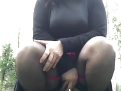 Sandra is pissing outdoor
