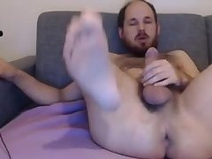 Uncut hairy young cock jerker