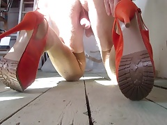 teasing with orange platform heels