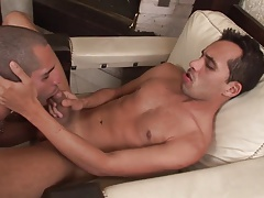 Sexy stud loves to suck his partner's cock in the living room
